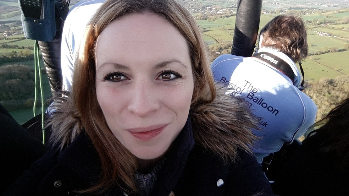 Woman smiling on a hot air balloon flight over Bristol