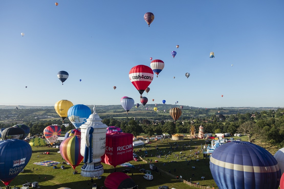 Balloons flying over Bristol on a sunny day at the Bristol International Balloon Fiesta