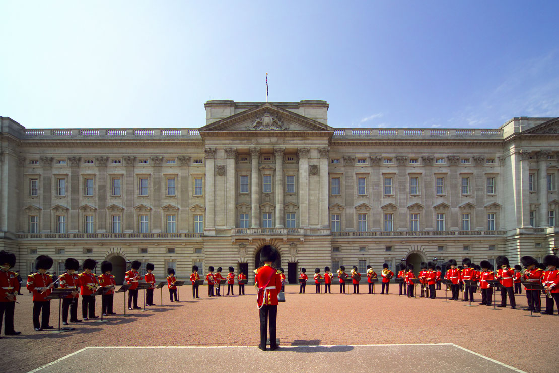 Buckingham Palace with guards trooping the colour