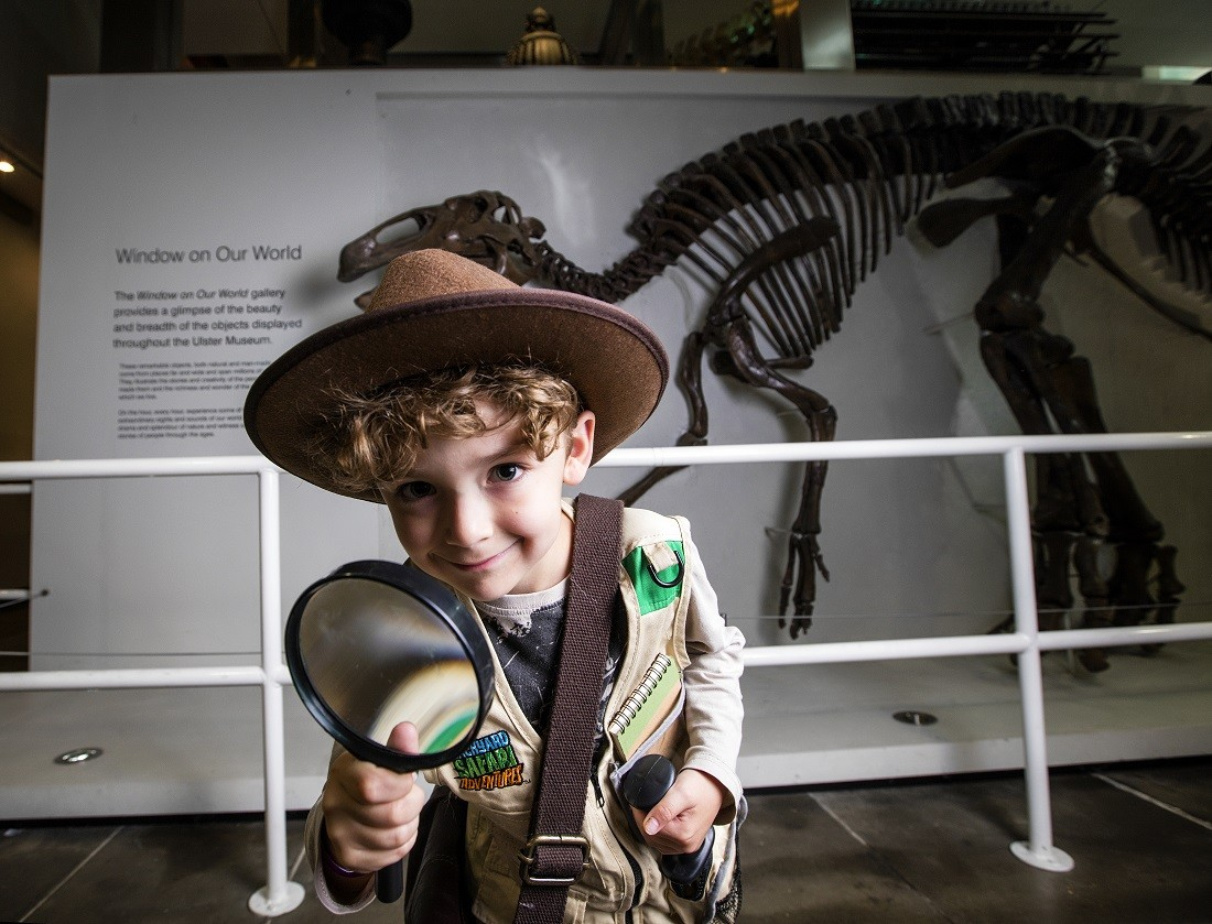 Child dressed in an explorers outfit at Ulster Museum located in the Botanic Gardens in Belfast. Image credited VisitBritain and Discover Northern Ireland.