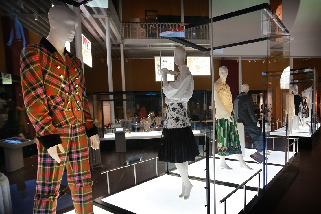 New fashion exhibition at National Museum of Scotland, featuring a mannequin in the foreground in tartan