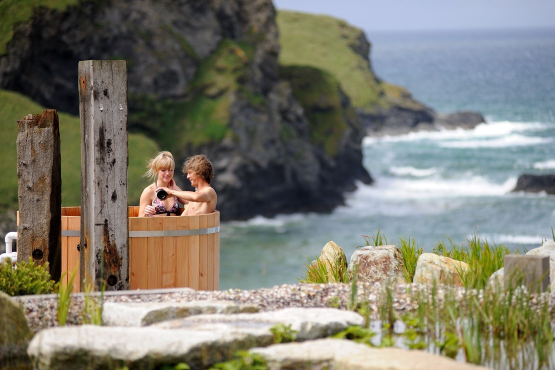 Guests enjoying a cliff top Jacuzzi at the Scarlet Hotel in Cornwall, England