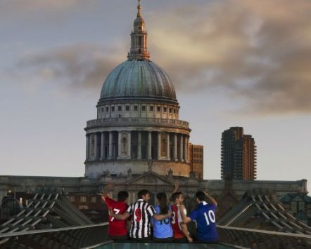Football fans sitting in front of St Paul's Cathedral