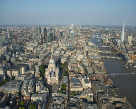 London Skyline. View from the west to the east along the River Thames, with a series of historic bridges, and the city of London buildings, including St Paul's cathedral.