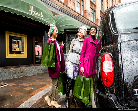 Women enjoying luxury shopping at Harrods
