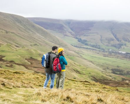 Young couple hiking in the Peak District National Park, Derbyshire.