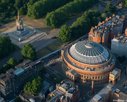 The Royal Albert Hall, London. A round concert hall and memorial to Prince Albert, built by his Queen Victoria, in the 19th century.