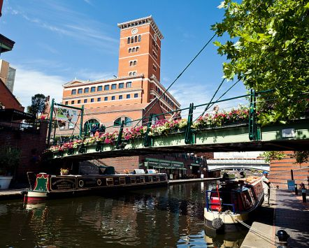 Birmingham city centre has areas which have been regenerated and Brindleyplace or Brindley Place runs along the old canal. Pubs and bars.