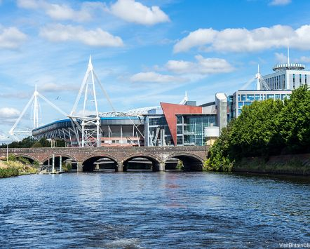 Cardiff Principality Stadium from river, bridge over River Taff.