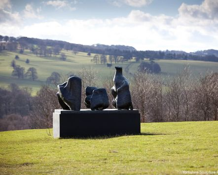 Yorkshire Sculpture Park. A collection of outdoor sculptures in Yorkshire. A sculpture atop a plinth, with rolling hills behind.