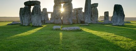 Stonehenge is a large henge or stone circle in Wiltshire, and an internationally recognised travel destination. Huge standing stones were dragged to the site and placed in the landscape in the era 2,500 BC. It is a UNESCO world heritage site.