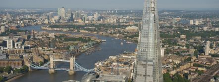 London Skyline. View from the west to the east along the River Thames, with a series of historic bridges, and the city of London buildings. The Shard tower.