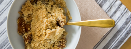 Apple Crumble with stripey tablecloth