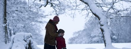 Woman and child in the snow at Box Hill, Surrey.