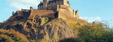 Edinburgh Castle, ramparts and gothic architecture, Edinburgh gardens trees.