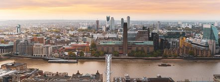 View at sunrise from the top of the St Paul's dome featuring Millennium Bridge and city