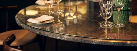 City Social Restaurant, London, England. Dining table with place settings and wine glasses
