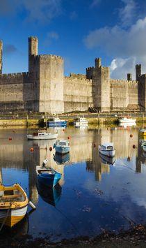 Caernarfon castle overlooking the Menai straits, Wales.