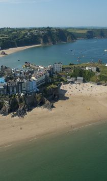 Tenby is a traditional seaside town in Wales, with sandy beaches, and a historic castle on the Pembrokeshire coastline, on the west side of Carmarthen Bay.