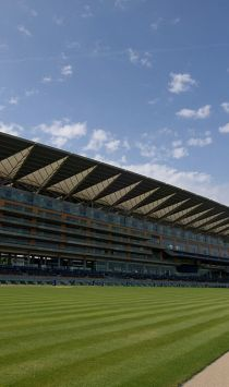 Ascot Race Course. The grandstand building, and the green turf of the race course, at the One Mile post.