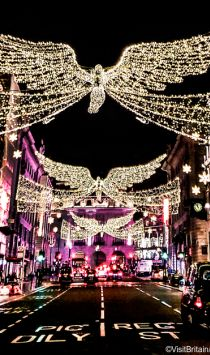 Christmas light display above traffic on Regent Street, London, England. Credit to VisitBritain/ Leyla Cobián