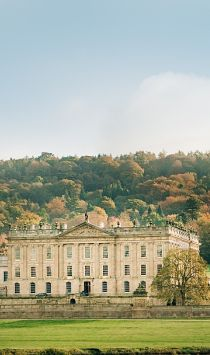 Front view of Chatsworth House with hills behind, Peak District, Derbyshire, England Credit to VisitBritain/Jon Attenborough