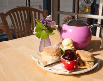 A traditional cream tea on a table in a cafe in Lustleigh, South Devon.