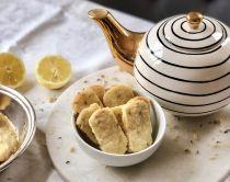 shortbread with tea pot on table