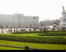 Buckingham Palace in the Mall. The royal residence of the Queen. Queen Victoria memorial at the centre of the traffic flow.