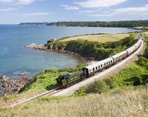 A steam train moving along the Devon coast in southern England.