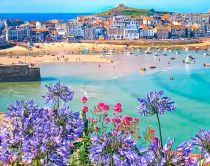 View of the beach and boats moored at St Ives, Cornwall, England.