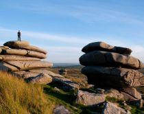 Roughtor, Bodmin Moor. Man looks out across moorland.