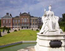 Kensington Palace, a royal residence in the Royal Borough of Kensington and Chelsea in London, England. Statue of Queen Victoria in white marble.