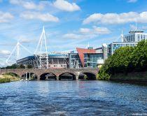 Cardiff Principality Stadium from river, bridge over River Taff.