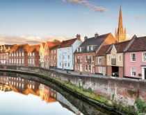 Historic town houses overlooking the river Wensum, Norwich, Norfolk, East Anglia, England. Credit to VisitBritain/Helen Hotson