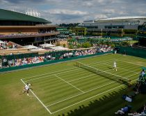 General View of Court 18 with Centre and Number 1 Court behind. The Championships 2019. Held at The All England Lawn Tennis Club, Wimbledon. Day 2 Tuesday 02/07/2019. AELTC/Ben Queenborough
