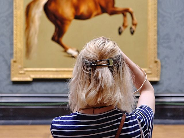 A girl admiring art at the National Gallery, London