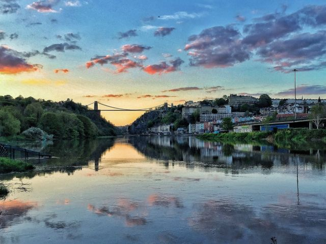 Bristol Waterfront at sunset, with the Clifton Suspension Bridge in the distance, North Somerset, England.