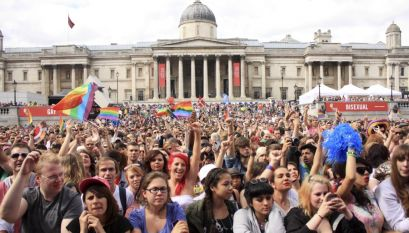 Pride. The London 2012 parade and event held to celebrate World Pride. Crowds filling Trafalgar Square in front of the National Gallery.