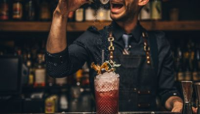 A barman making a cocktail in Cahoots bar, London.
