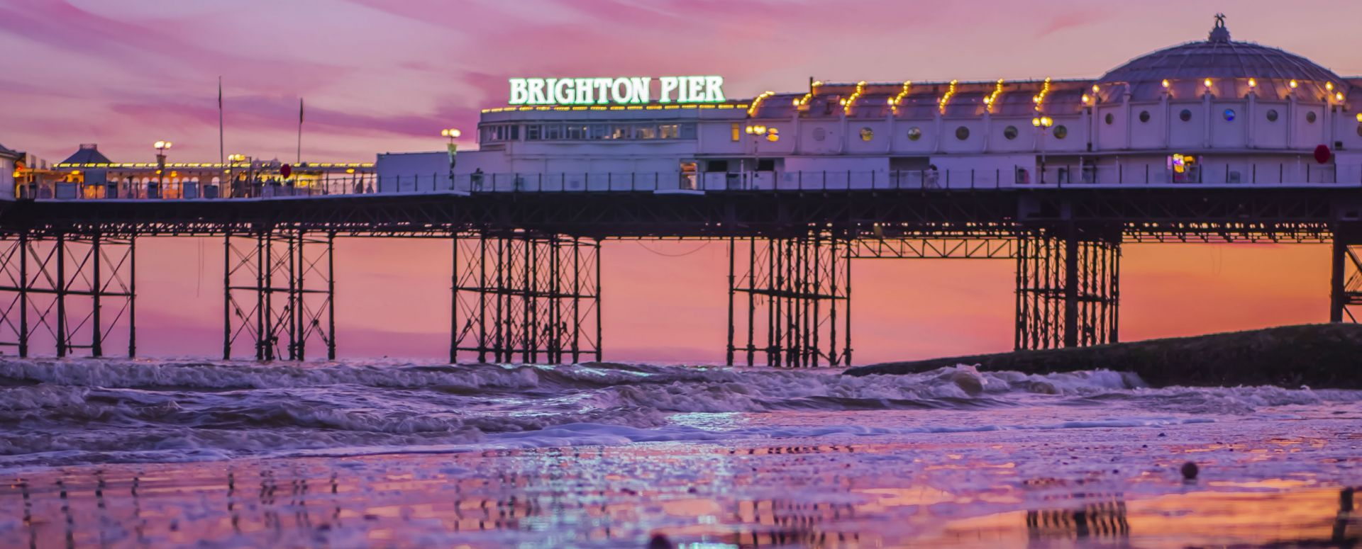 Brighton Pier bathed in the light of a vivid sunset Brighton, East Sussex
