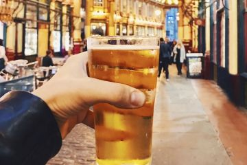 Drinking a pint in Leadenhall Market, London