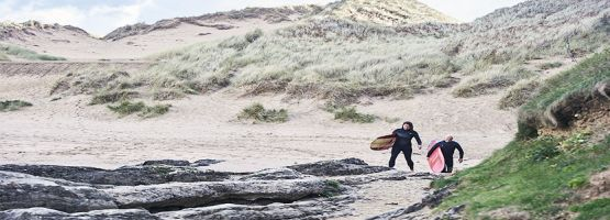 People on surfboards in Devon