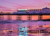 Brighton Pier bathed in the light of a vivid sunset Brighton, East Sussex.