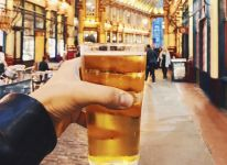 Drinking a pint, Leadenhall Market, London, England