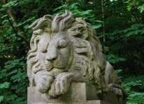 Sleeping lion statue at Highgate Cemetery, London