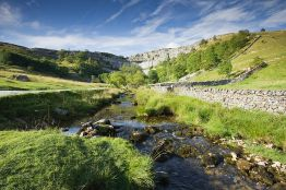 Yorkshire Dales National Park. Malham Cove is a curved crag of carboniferous limestone.