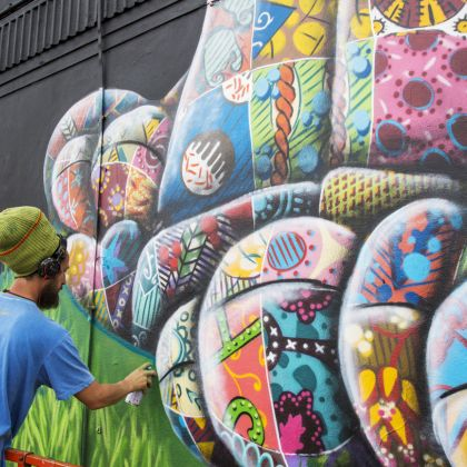 Artist Louis Masai with a can working on an artwork at Upfest, Europe's largest Street Art and Graffiti Festival, Bristol, England.