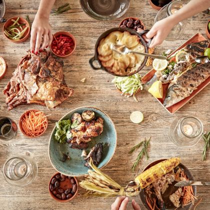 View from above of a dining table covered in plates of food