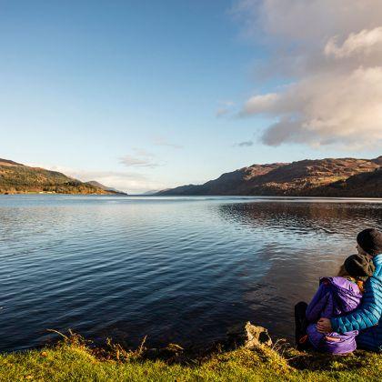 A couple looking across Loch Ness, Scotland